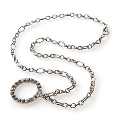 Is it a necklace or is it an eyeglasses holder? Well, it's both! Our Isabel necklace has been designed specifically for women who frequently wear eyeglasses or sunglasses. The chunky silver link chain and large clear rhinestone-encrusted loop pendant join together seamlessly to create a necklace that doubles as a holder for your specs.