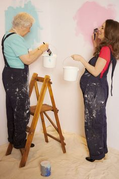 HRH Elizabeth II, Queen of England and the Commonwealths & her granddaughter Catherine, Duchess of Cambridge painting the royal nursery