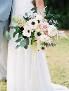 This muted bouquet featured anemones, greenery, and bluish-gray berries, and was created by Sarah's Garden.