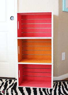 This DIY wood crate bookshelf is colorful and simple, but make sure to go through and see how sweet this looks in her kids' bedroom. Diy Bookshelves For Kids, Bookshelf Ideas, Baby Bookshelf, Crate Bookshelf, Bookshelf Plans, Simple Bookshelf, Bookcase Headboard, Twin Headboard, Kids Bookcase