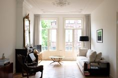 Sri's Classic & Contemporary Amsterdam Home- love the curtain style for my wool ones- and the couch