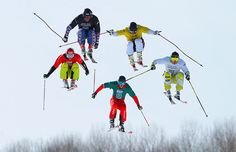 Some more Winter X competitors soar through the air. This time it's skiers Christian Mithassel (yellow) ahead of Casey Puckett (black), Dave Duncan (white), Daniel Bohnacker (red) and Alex Fiva (green). Mithassel held the lead to win the semi-final of the Men's Skier X Photograph: Doug Pensinger/Getty Images
