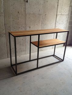 Free freight shipping on this item. Made-to-order dual shelf console table. 1 steel tube stock frame, with a natural black ash surfaces. Industrial Table, Industrial Furniture, Rustic Furniture, Diy Furniture, Modern Furniture, Furniture Design, Steel Table, Steel Furniture, Wood And Metal