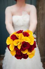 Flamenco Bridal Bouquet of lush red roses and gorgeous yellow calla lilies  www.bergeronsflowers.com