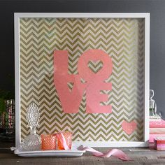 Make a custom piece of art with pretty gift wrap and this LOVE template. See tutorial.