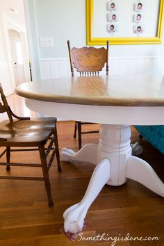 Refinished Round Pedestal Table with white painted base. {www.somethingisdone.com} #paintedtable