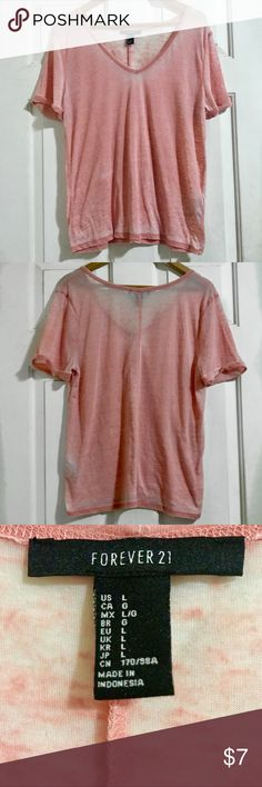Forever 21 Salmon Faded Wash V-Neck Tee This Forever 21 relaxed v-neck tee is perfect for those days where you wanna dress casual & comfy but cute at the same time! ✨ I have never worn this because it's a bit sheer for my liking. It's in very good condition!   Product details:  - 55% Polyester & 45% Cotton  - Cuffed sleeves Forever 21 Tops Tees - Short Sleeve