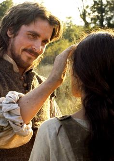 Christian Bale & Q'Orianka Kilcher in The New World ... please look at me like that.  just once would be enough.