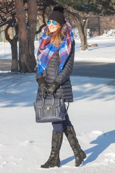 Elena is wearing Burberry jacket, Zara Scarf, Ray Bans, 3.1 Philip Lim bag and Donald Pliner boots - details at http://redlipstickoptional.com/2016/02/10/on-the-cold-day-puffy-jacket/