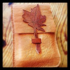 Leather iPhone case in hand-stitched tanned leather with maple leaf application. $34.00, via Etsy.