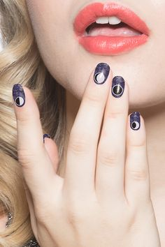 Welcome to the dark side, of the moon. Where you're always the center of Earth's attention and your nails look beautiful. Some might even say out of this world.