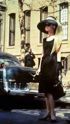 The beehive, the pearls and the sunglasses, the broad brimmed hat, the feathered hem, the long cigarette holder all work with the same Little Black Dress!