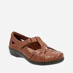 Inspired by classic t-strap styles, this women's casual sandal is updated with a cutout design and walkable low heel. An adjustable hook-and-loop strap, textile linings, a CushionSoft with OrthoLite® footbed, and TPR outsole add Clarks Collection comfort. Cute with jeans or dresses, this shoe is super versatile.