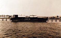 Broadside starboard view of the oil storage barge USS YOS-1. Photograph received 1950. Official U.S. Navy Photograph, now in the collections of the National Archives.