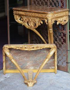 Paire de consoles en bois doré sculpté dessus marbre, une époque Régence et l'autre au modèle. #régence . #18th century. For sale on #Proantic by Olivier d'Ythurbide et Associé