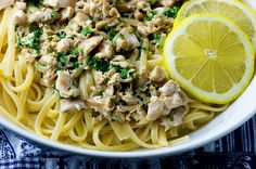 Linguine with Clam Sauce Recipe Main Dishes with linguine, olive oil, butter, clove, clams, white wine, lemon, chopped parsley, heavy cream, salt, ground pepper, parmesan cheese