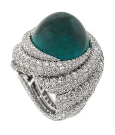 Tropical Storm ring in platinum with a 22.1 ct. emerald and 11.47 cts. t.w. diamonds by James Currens, J.W. Currens Inc.