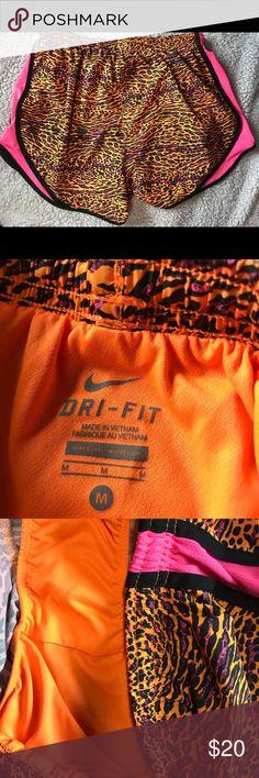 Nike DriFit Shorts Like new condition! Cute cheetah print Nike DriFit shorts with orange and pink details 💕🎉💕 Nike Shorts