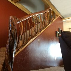 Finished Staircase at my home!  #staircase #logs  My log stair rail finished