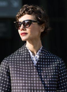 Patterns outside Kenzo, coat, sunglasses, short hair / Garance Doré