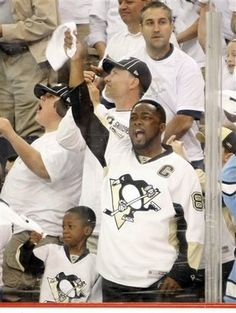 Pittsburgh Steelers coach Mike Tomlin celebrating a Penguin goal