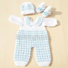 Hand knitted baby bobble romper hat and bootie set made to order 0 - 6 months This baby romper set is really pretty with bobbles and twisted stitches. The rompers can be made with long legs as shown or short legs. Short Legs, Long Legs, Knitted Baby, Baby Knitting, Handmade Baby Clothes, Drops Design, Handmade Crafts, 6 Months, Cyber