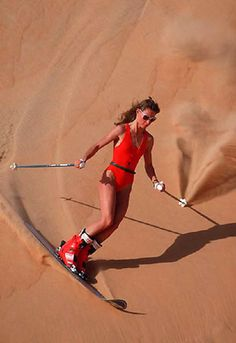 Monoski on sand in the desert of Leewa, Saudi Arabia