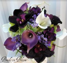 I love this color scheme... black, white, plum/eggplant, and a little bit of chartreuse green.