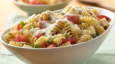 Caprese salad and pasta combine to make a tasty Italian side dish.