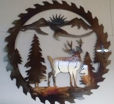 Deer Sawblade, Metal Art - HEAT COLORED, 20 (51 cm)  This is a plasma cut metal art, wall decor.  Cut from 16 gauge steel (1.5 mm thick)  It measures 20 in diameter (51 cm).  Color: Heat Colored  Please note that each piece is one of a kind because of the RANDOM PATTERN of surface finishing that catches light from different angles and the coloration technique which is achieved by heating! A durable clear coat is applied to protect the colored finish.  Please note that I am shipping from…