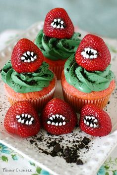 "For halloween, create rows of sharp ""teeth"" on strawberries for those delicious cupcakes. It will certainly add a scary touch to that sweet dessert."