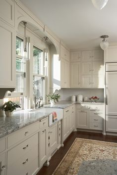 Victorian Kitchen in Neutral Tones love the ceiling light, crystal knobs and muted oriental rug