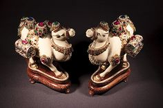 Pair of ivory camels carrying treasure chests, all encrusted with 1,000 diamonds, emeralds, rubies and sapphires. Smithsonian.