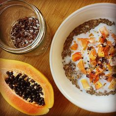 It's a papaya kinda day - the sun is shining and hopefully summer had arrived in the UK. Cacao nibs add a lovely crunch and thick silky coconut milk (and chia seeds!) should help get me going for the day.  #porridgediaries #porridge #oatmeal #breakfast #healthy #glutenfree #vegan #vegetarian #hbloggers #coconut #papaya #chia #cacaonibs