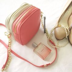 "NWT Olivia + Joy coral and white cross body Beautiful coral and white purse with cross body strap and gold chain accent and zippers. Measures 6.5"" x 7"" x 3.5"" total, with two separate compartments. Still has tag and tissue stuffing in compartments. Olivia + Joy Bags Crossbody Bags"