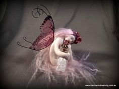 Handmade polymer clay fairy with bottle of fairy tears  By Mermaids Dreaming