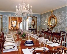 Chippendale chairs surround a circa 1815 table in the dining room. A Regency mirror is above the sideboard | archdigest.com