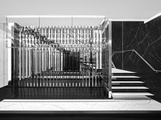 The art deco inspired Saint Laurent flagship store on Avenue Montaigne in Paris has black and white marble floors and walls, and nickel plated brass bars for displaying clothes. Interior Stairs, Retail Interior, Interior And Exterior, Interior Design, Interior Modern, Saint Laurent Store, Saint Laurent Paris, Modern Staircase, Staircase Design