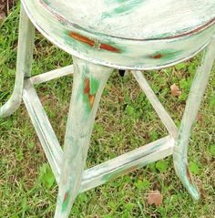 Old White and Antibes Green Annie Sloan Chalk Paint over Primed Red Vintage Metal Stool.  Brown wash for aging.