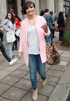 Impromptu catwalk: Frankie Sandford looked pretty in a pastel pink coat and jeans as she a...