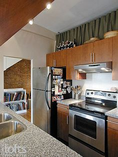 Use The Space Above Kitchen Cabinets For Extra Storage In A Small - Above kitchen cabinet storage ideas