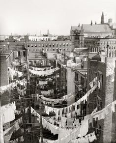 """Circa 1900-1910. """"Yard of tenement, New York City."""" Hung out to dry somewhere in Manhattan. Detroit Publishing Company glass negative."""