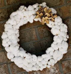 This gorgeous #wreath is made from cotton. Wouldn't it make the cutest summertime accent for your front door? | From Amanda of AmandaJaneBrown.com