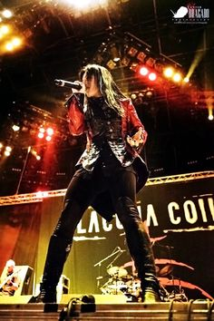 Cristina Scabbia. (Lacuna Coil)  This woman is a force to be reckoned with:  -badass pipes -awesome style -and the ability to never age!
