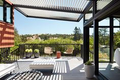A slated shade covers a deck at the back of the home. Modern Balcony, Balcony Design, Building A Deck, Mid Century House, Layout Design, Design Ideas, Home Renovation, Architecture Design, Mid-century Modern