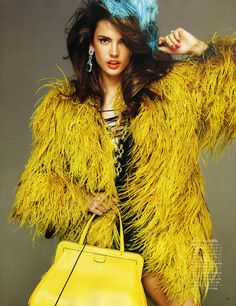 Alessandra Ambrosio 'Never Enough' - Only this fashion model is able to pull off a Big Bird-inspired coat and look mighty fine doing it. The Alessandra Ambrosio 'Never Enough' Vogue Ni. Alessandra Ambrosio, Fashion Models, High Fashion, Vogue Fashion, Fashion Shoot, Style Fashion, Fashion Beauty, Feather Coat, Feather Fashion