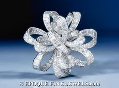 Van Cleef & Arpels ,An impressive Art Deco diamond flot de rubans bow brooch,