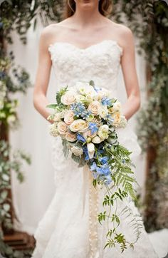 Beautiful blue and white cascading bridal bouquet - Photo: DianaMcGregor designed by fleurie #weddings #blue #bouquet