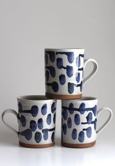 This listing is for one Polka-dot Mug. White with blue drippy dots on a dark brown stoneware clay. Mugs are a good size and can hold about 14 oz.  All handmade in my New Hampshire studio, these guys are thrown on the potters wheel. Flat base stamped with melabo on the side. Just under 4.5 inches tall. ( 11 cm) Opening diameter of about 3.5 inches. Handles fit 2 fingers comfortably. The mugs are not identical. Each has minor variation, but the group could still function as a set. (although…