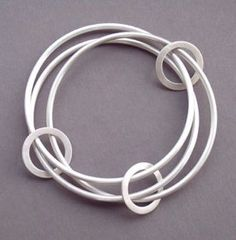 Eternity BangleHand forged from solid sterling silver. This wearable chunky bangle is made with 3 2.5mm thick round bangles and 3 moveable ring connecting them. (Matt or polished finish)Made to order.